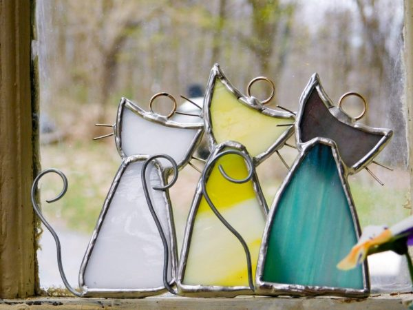Back side with tails of stained glass cat suncatchers