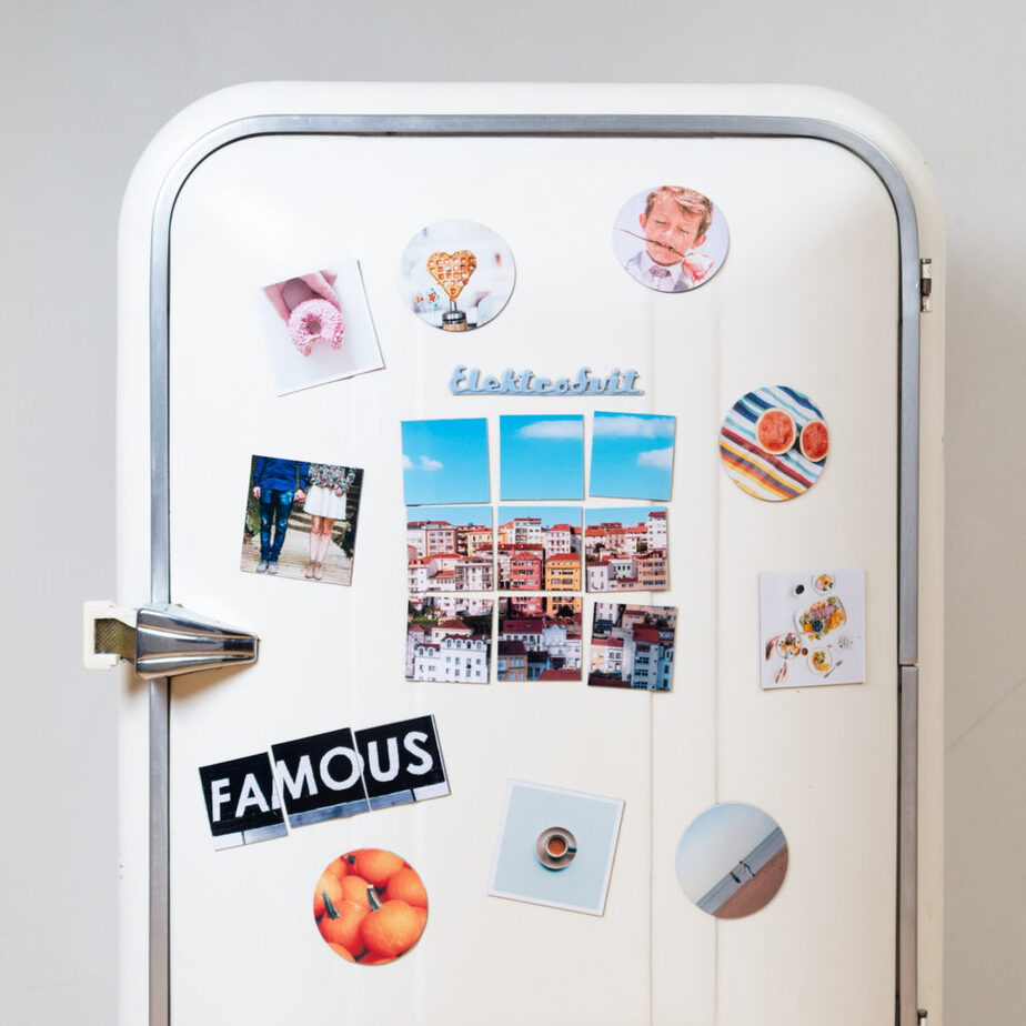 vintage refrigerator with photos and magnets